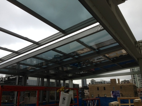The retractable roof being installed at I|O Urban Roofscape.