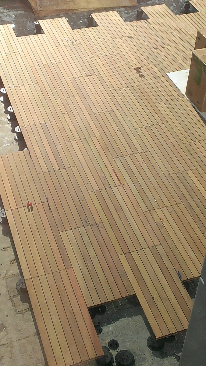 New flooring at i o urban roofscape building the godfrey for Godfrey design build