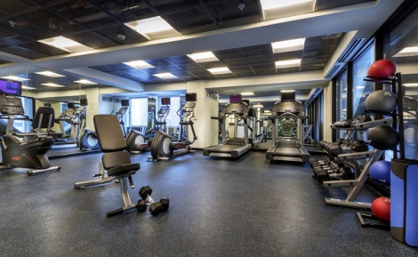Another view of the fitness room at The Godfrey Hotel Chicago. Television screens allow you to catch up on news and other programs while you work out.