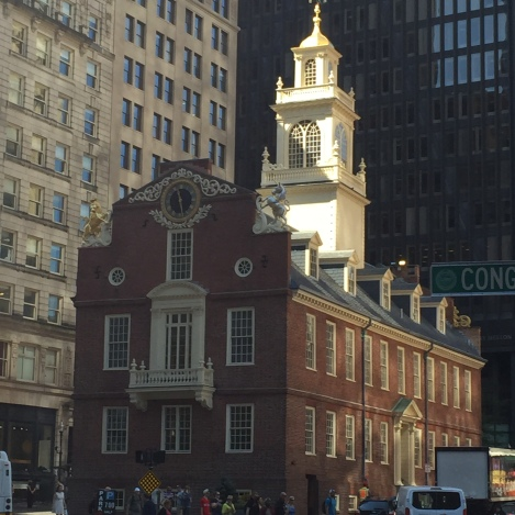 At the corner of Washington and State streets, you'll see the Old State House, which is a historic building in Boston.